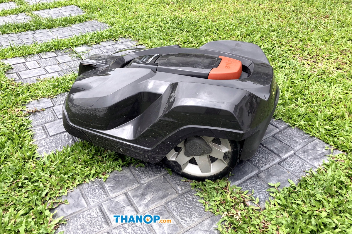 Robot Lawn Mower Working on Garden Tile