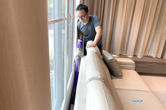 Dyson Digital Slim Cleaning Back of Sofa